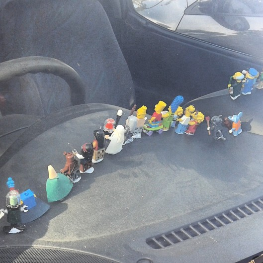 Day 13 - I spy with my little eye a whole collection of figurines on a dashboard